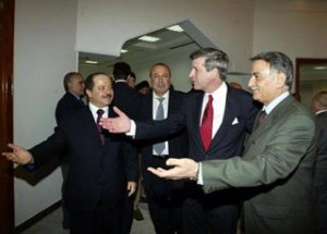U.S. administrator Paul Bremer, red tie, and Yonadam Kanna, right